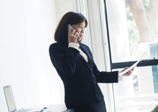 Beautiful business woman is working. Business woman working in office royalty free stock photo