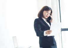 Beautiful business woman is working. Business woman working in office royalty free stock photos
