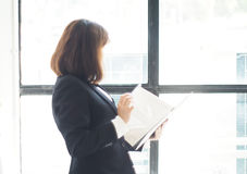 Beautiful business woman is working. Business woman working in office royalty free stock image