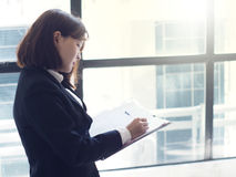Beautiful business woman is working. Business woman working in office stock photography