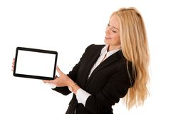 Beautiful business woman working on tablet computer isolated ove Stock Image