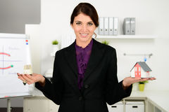 Beautiful business  woman worry about heating costs. In office Stock Images