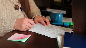 Business woman write, check and sign documents in office stock video footage