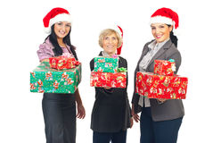 Beautiful business women holding X-mas gifts Royalty Free Stock Images