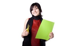 The beautiful businesswoman. The young beautiful businesswoman at office behind work on a white background Stock Images