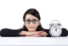 Beautiful businesswoman with alarm clock Royalty Free Stock Photography