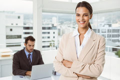 Beautiful businesswoman with arms crossed at office Stock Images