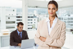 Beautiful businesswoman with arms crossed at office Royalty Free Stock Image