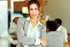Beautiful businesswoman with arms folded standing Stock Photos