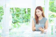 Beautiful businesswoman asian have enjoyed in the garden. Stock Photos