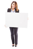 Beautiful businesswoman with a big sign Stock Photography