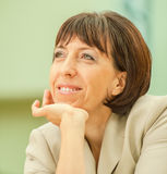 Beautiful businesswoman in bright suit Stock Photography