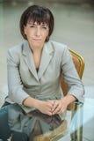 Beautiful businesswoman in bright suit Stock Image