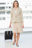 Beautiful businesswoman on a business trip. Full length portrait of a beautiful businesswoman on a business trip Royalty Free Stock Photos