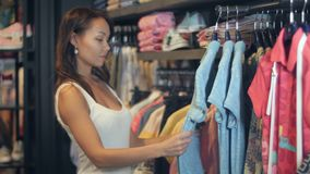 Beautiful businesswoman buying clothes stock video footage