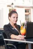 Beautiful businesswoman in cafe. Beautiful businesswoman working in cafe Stock Photos