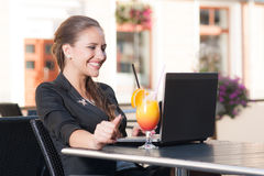 Beautiful businesswoman in cafe. Beautiful businesswoman working in cafe Stock Photo