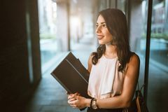 Beautiful businesswoman carrying folders stock images