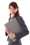 Beautiful businesswoman carrying a laptop Stock Photo