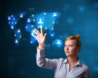 Beautiful businesswoman choosing from social network map Stock Image