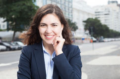 Beautiful businesswoman in the city Stock Image