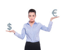 Beautiful businesswoman with currency symbols Royalty Free Stock Photo