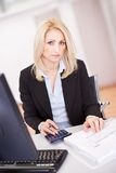 Beautiful businesswoman doing finances Stock Photo