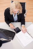 Beautiful businesswoman doing finances Royalty Free Stock Image