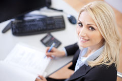 Beautiful businesswoman doing finances Royalty Free Stock Images