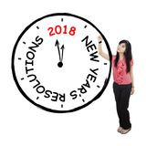 Beautiful businesswoman drawing a clock Stock Images