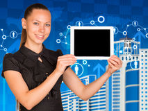 Beautiful businesswoman in dress holding tablet pc Stock Photography