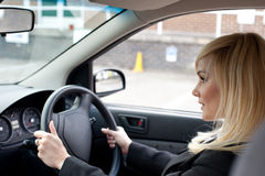 Beautiful Businesswoman Driving A Car Royalty Free Stock Image
