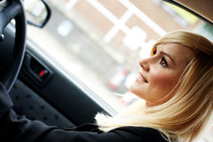 Beautiful businesswoman driving a car Stock Image