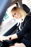Beautiful businesswoman driving a car Stock Photo