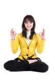 Beautiful businesswoman exercising yoga . Stock Photography