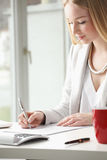 Beautiful businesswoman fill the form Stock Photo