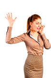 Beautiful businesswoman gesturing and talking on phone Stock Photography