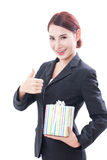 Beautiful businesswoman with gift box Royalty Free Stock Photos