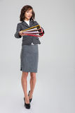 Beautiful businesswoman giving folders to you. Beautiful attractive curly young businesswoman giving folders to you royalty free stock photography