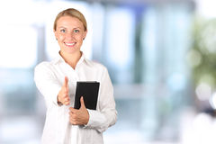 Beautiful  businesswoman giving a handshake Stock Images