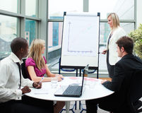 Beautiful businesswoman giving a presentation Stock Photos