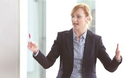 Beautiful businesswoman giving presentation in conference room stock video