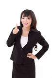 Beautiful businesswoman giving, showing thumb up hand gesture Stock Images