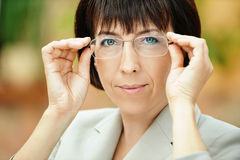 Beautiful businesswoman with glasses Stock Photo