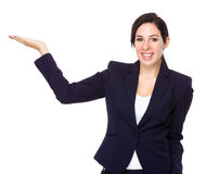 Beautiful businesswoman with hand show with blank sign Royalty Free Stock Images