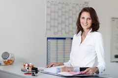 Beautiful businesswoman handles files Royalty Free Stock Photography