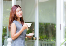Beautiful businesswoman have enjoyed in the garden with coffee. Royalty Free Stock Photo