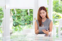 The beautiful businesswoman have enjoyed in the garden with tablet. Beautiful businesswoman have enjoyed in the garden with tablet Stock Photos
