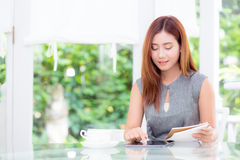 Beautiful businesswoman have enjoyed in the garden with tablet. The beautiful businesswoman have enjoyed in the garden with tablet Royalty Free Stock Photos