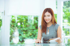 Beautiful businesswoman have enjoyed in the garden with tablet. Stock Photography